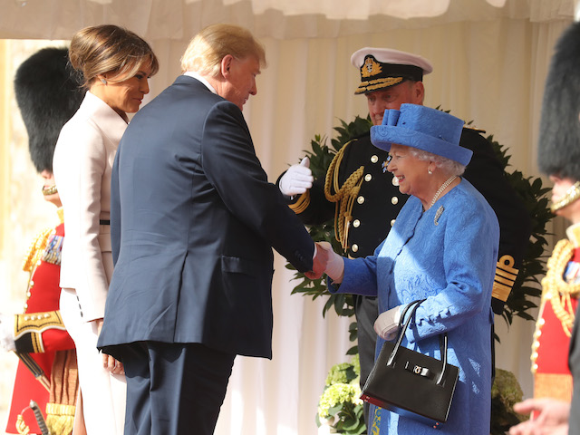 Queen Elizabeth II greets President of the United States, Donald Trump and First Lady, Melania Trump at Windsor Castle on July 13, 2018 in Windsor, England. Her Majesty welcomed the President and Mrs Trump at the dais in the Quadrangle of the Castle. A Guard of Honour, formed of the Coldstream Guards, gave a Royal Salute and the US National Anthem was played. The Queen and the President inspected the Guard of Honour before watching the military march past. The President and First Lady then joined Her Majesty for tea at the Castle. (Photo by Chris Jackson/Getty Images)