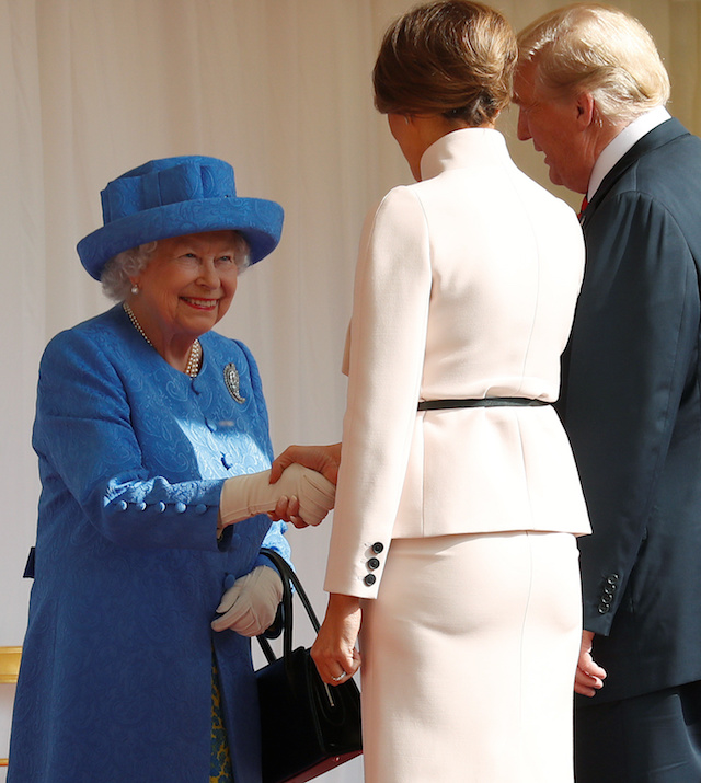 U.S. President Donald Trump and the First Lady Melania Trump are met by Britain's Queen Elizabeth as they arrive for tea at Windsor Castle in Windsor, Britain, July 13, 2018. REUTERS/Kevin Lamarque