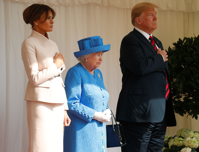 U.S. President Donald Trump and the First Lady Melania Trump listen to the Coldstream Guards, play the U.S. national anthem, with Britain's Queen Elizabeth, during a visit to Windsor Castle in Windsor, Britain, July 13, 2018. REUTERS/Kevin Lamarque