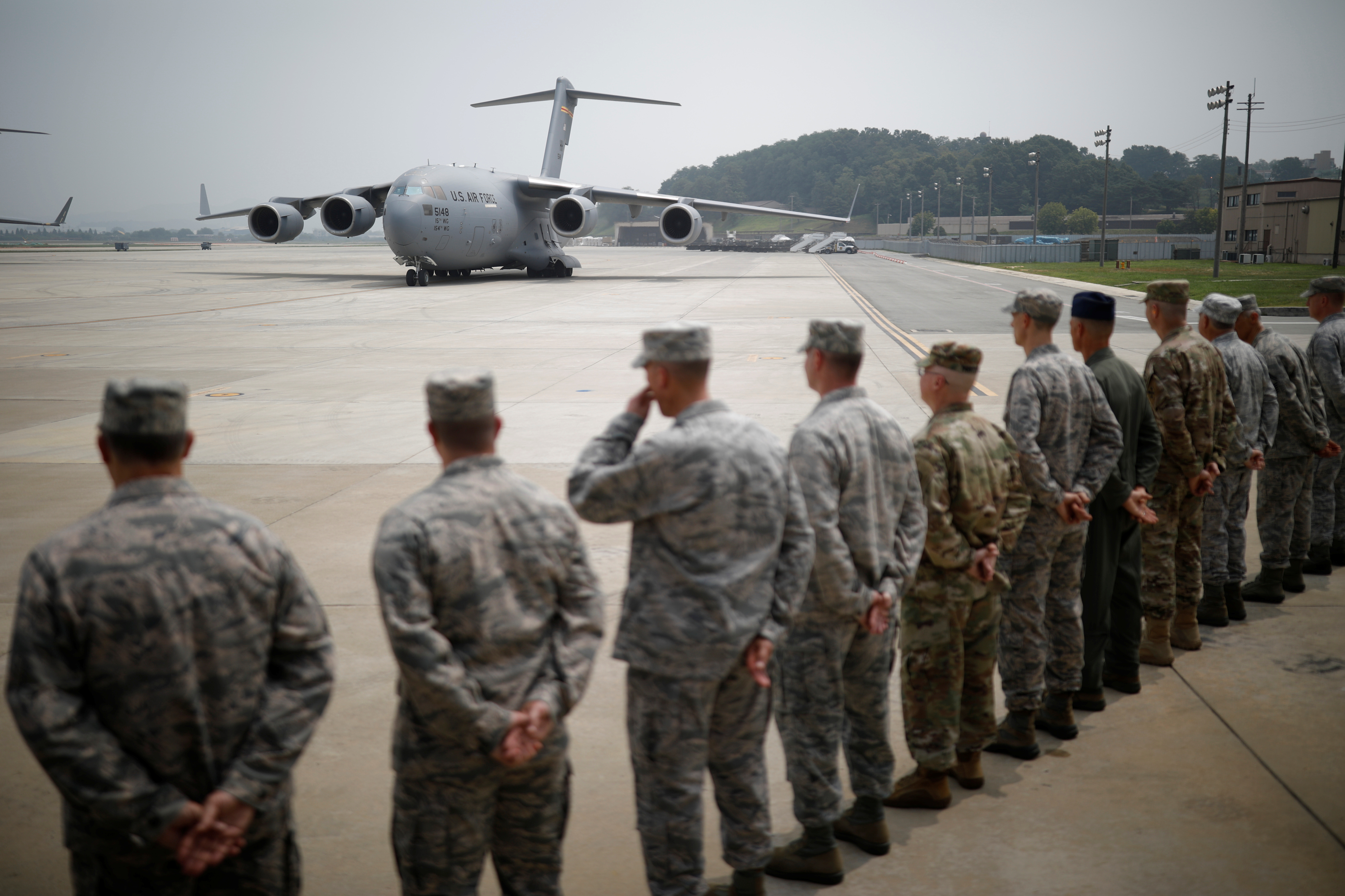 A U.S. cargo aircraft carrying the remains of 55 U.S. soldiers who were killed in the Korean War arrives at Osan Air Base in Pyeongtaek, South Korea, July 27, 2018. REUTERS/Kim Hong-Ji/Pool -