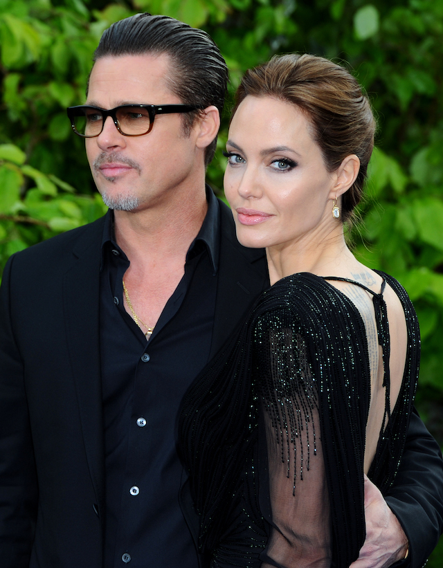"Brad Pitt and Angelina Jolie attend a private reception as costumes and props from Disney's ""Maleficent"" are exhibited in support of Great Ormond Street Hospital at Kensington Palace on May 8, 2014 in London, England. (Photo by Anthony Harvey/Getty Images)"