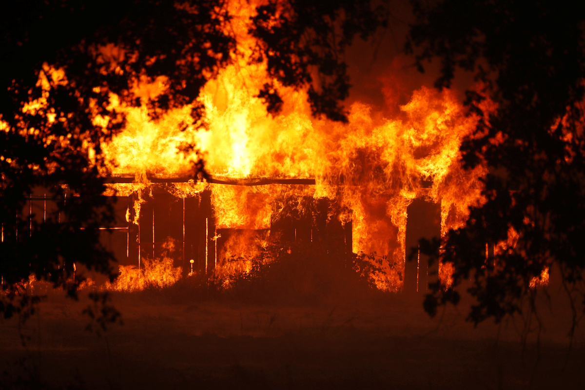 A structure burns out of control in the River Fire (Mendocino Complex) in Lakeport, California, July 31, 2018. REUTERS/Fred Greaves