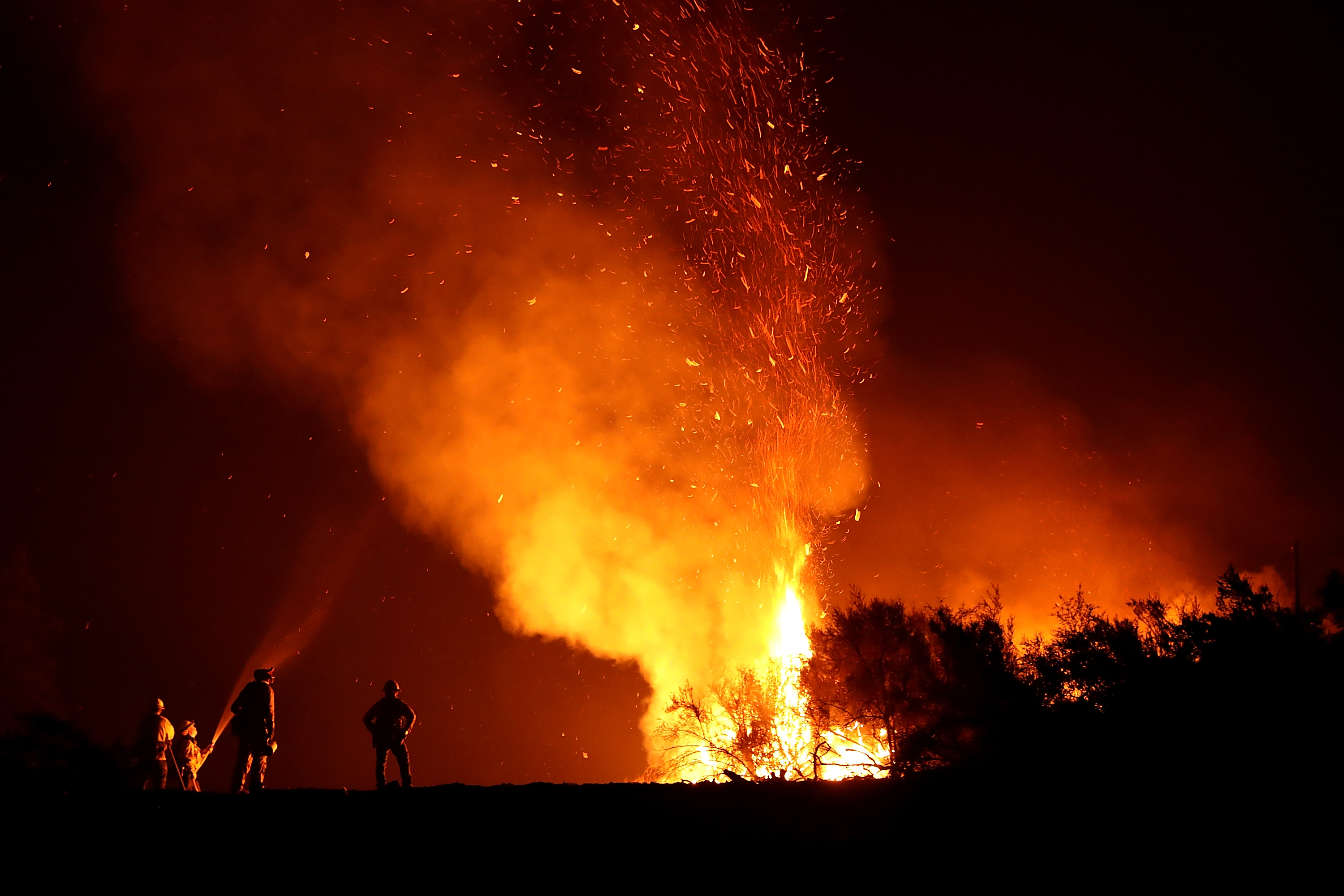 LODOGA, CA - AUGUST 07: Cal Fire firefighters monitor a back fire as they battle the Medocino Complex fire on August 7, 2018 near Lodoga, California. The Mendocino Complex Fire, which is made up of the River Fire and Ranch Fire, has surpassed the Thomas Fire to become the largest wildfire in California state history with over 280,000 acres charred and at least 75 homes destroyed. (Photo by Justin Sullivan/Getty Images)