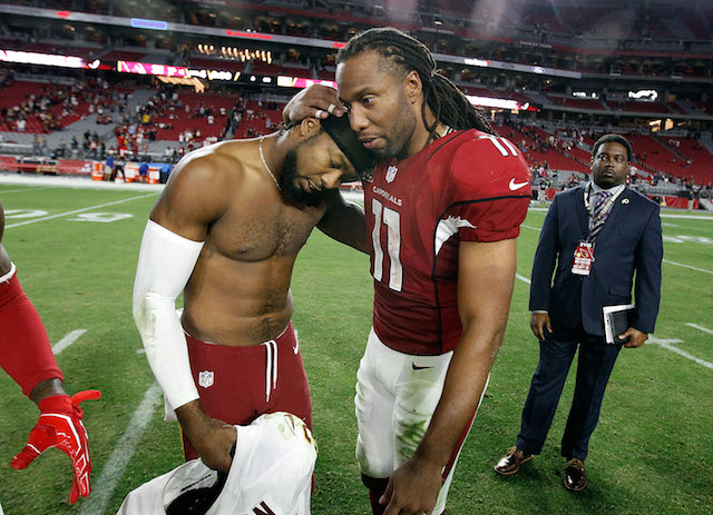 Larry Fitzgerald #11 of the Arizona Cardinals embraces Josh Norman #24 of the Washington Redskins following a game at University of Phoenix Stadium on December 4, 2016 in Glendale, Arizona. The Cardinals defeated the Redskins 31-23. (Photo by Ralph Freso/Getty Images)