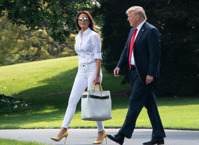 US President Donald Trump and First Lady Melania Trump walk to board Marine One at the White House in Washington, DC, on July 27, 2018 as they head to spend the weekend in New Jersey. (Photo credit: NICHOLAS KAMM/AFP/Getty Images)
