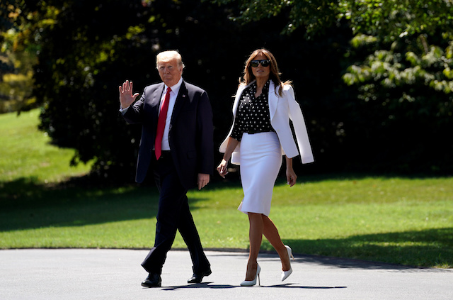 U.S. President Donald Trump and first lady Melania Trump depart the White House in Washington, U.S., August 24, 2018. REUTERS/Kevin Lamarque