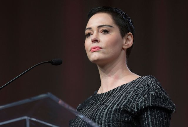 US actress Rose McGowan gives opening remarks to the audience at the Women's March / Women's Convention in Detroit, Michigan, on October 27, 2017. A stream of actress including Rose McGowan, models and ex-employees have come out, many anonymously, to accuse Hollywood producer Harvey Weinstein of sexual harassment and abuse dating as far back as the 1990s. / AFP PHOTO / RENA LAVERTY (Photo credit: RENA LAVERTY/AFP/Getty Images)
