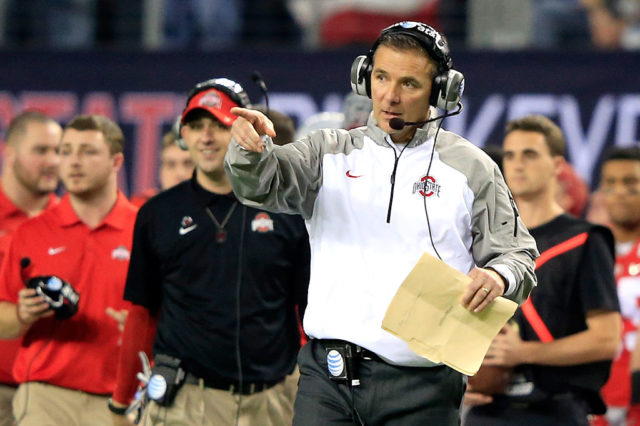 ARLINGTON, TX - JANUARY 12: Head Coach Urban Meyer of the Ohio State Buckeyes points in the second half against the Oregon Ducks during the College Football Playoff National Championship Game at AT&T Stadium on January 12, 2015 in Arlington, Texas. (Photo by Jamie Squire/Getty Images)