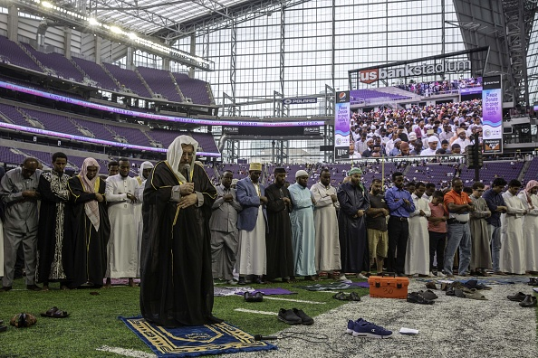 Muslim worshippers pray at the US Bank Stadium during celebrations for Eid al-Adha on August 21, 2018 in Minneapolis, Minnesota. - The US Bank Stadium, home of the National Football League's Minnesota Vikings, is hosting thousands for the event that organizers are calling Super Eid. The holiday, one of the holiest of the year for Muslims, honors the Prophet Ibrahim, also known as Abraham in Judaism and Christianity, and comes at the end of annual hajj pilgrimage. (Photo: KEREM YUCEL/AFP/Getty Images)