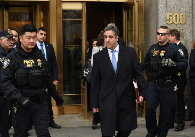 """US President Donald Trumps former attorney Michael Cohen leaves US Federal Court in New York on December 12, 2018 after his sentencing after pleading guilty to tax evasion, making false statements to a financial institution, illegal campaign contributions, and making false statements to Congress. - US President Donald Trump's former lawyer Michael Cohen delivered a blistering attack on his former boss as he was sentenced to three years in prison on December 12, 2018 for multiple crimes. """"It was my duty to cover up his dirty deeds,"""" Cohen said as he pleaded for leniency before US District Judge William H. Pauley III.Cohen, 52, said he was taking responsiblity for his crimes """"including those implicating the President of the United States of America."""" (Photo by TIMOTHY A. CLARY/AFP/Getty Images)"""